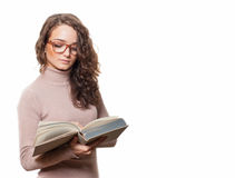 Student girl isolated on white. Female student reading a book isolated Royalty Free Stock Photo