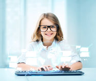 Student girl with keyboard and virtual screen. Education, school and future technology concept - little student girl with keyboard and virtual screen at school Royalty Free Stock Images