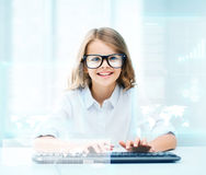 Student girl with keyboard and virtual screen. Education, school and future technology concept - little student girl with keyboard and virtual screen at school Royalty Free Stock Image