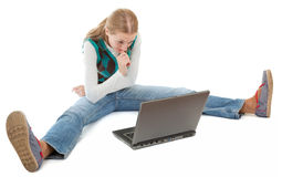 Student girl and laptop. On white background Royalty Free Stock Photography