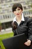 Student girl with laptop royalty free stock image