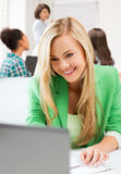 Student girl with laptop in college Royalty Free Stock Photos