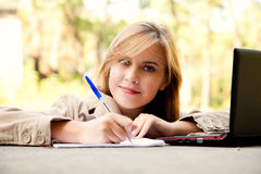 Student girl with a laptop in the park Royalty Free Stock Photos