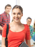 Student girl with laptop and school bag Stock Images