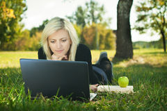 Student girl with laptop studying Royalty Free Stock Photography