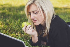Student girl with laptop studying in park Stock Photography