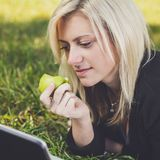 Student girl with laptop studying in park Royalty Free Stock Photography