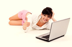 Student girl with laptop and thumb up Stock Photos