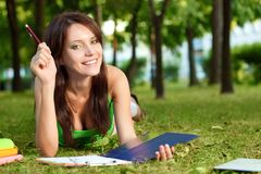 Student girl laying on grass Stock Photo