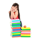 Student girl leaning on pile of books Stock Image