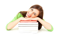 Student girl leaning on the pile of books Royalty Free Stock Photo