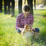 Student girl learning in nature with dog Royalty Free Stock Images
