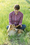 Student girl learning in nature with dog Royalty Free Stock Photo