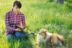 Student girl learning in nature with dog Royalty Free Stock Photos