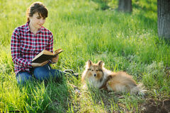 Student girl learning in nature with dog Stock Image