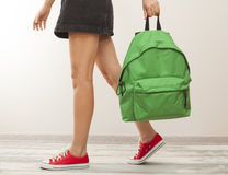 Student girl legs with backpack stock photo