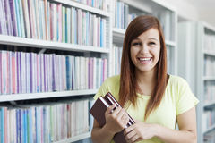 Student girl in library Stock Photography