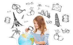 Student girl looking at globe with magnifier. People, tourism, vacation and summer holidays concept - little student girl looking at globe with magnifier over Stock Photos