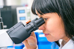 Student girl and microscope royalty free stock photo