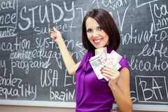 Student girl with money Stock Images