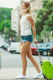 Student girl move out to city. Royalty Free Stock Image