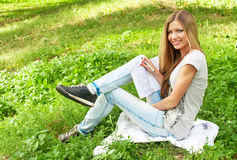 Student Girl On The Grass Stock Images