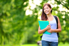 Student girl. Outdoor in park smiling happy going back to school. Asian female college or university student. Mixed race Asian / Caucasian young woman model Royalty Free Stock Photos