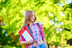 Student girl outdoors going back to school Stock Photo