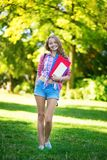Student girl outdoors going back to school Stock Images