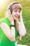 Student girl outside in park listening Royalty Free Stock Image