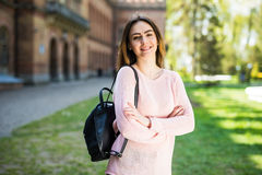 Student girl outside in summer park smiling happy. Caucasian college or university student. Young woman model wearing school bag o. Student girl outside in royalty free stock photos