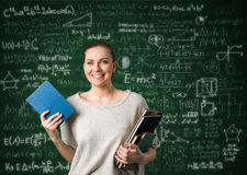 Student girl over education background. Student girl over  green background with formulas Stock Photo