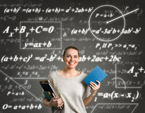 Student girl over education background. Student girl over  green background with formulas Royalty Free Stock Images