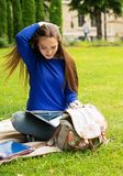 Student girl in a park Stock Photography