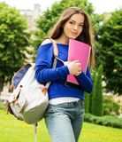 Student girl in a park Royalty Free Stock Photography