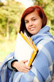 Student girl in the park in chilly day Stock Photography