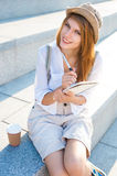 Student girl with pen and copybook Stock Photo