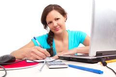 Student girl with pen in hand Stock Images