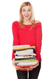 Student girl with a pile of heavy books Stock Photography