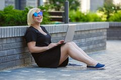 Student girl with laptop, meeting website stock photo