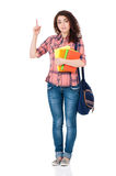 Student girl pointing up Royalty Free Stock Photo