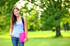 Student girl portrait holding books and backpack Royalty Free Stock Photos