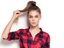 Student girl posing in red checkered shirt. Stock Image
