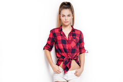 Student girl posing in red checkered shirt. Royalty Free Stock Photos