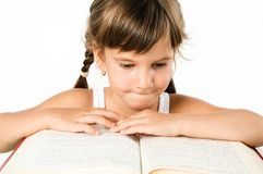 Student girl reading a big book isolated on white Stock Photos