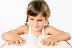Student girl reading a big book isolated on white Stock Images