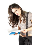 Student girl reading a book. A beautiful young student girl reading a book Royalty Free Stock Photography