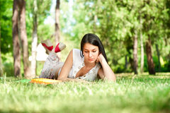 Student girl reading book in park Royalty Free Stock Photography