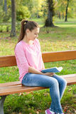 Student girl reading book Stock Photo