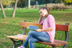 Student girl reading book Royalty Free Stock Photo